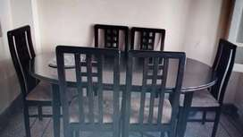 Wooden chairs and dining table