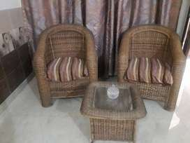 Cane chairs with coffee table and mirror