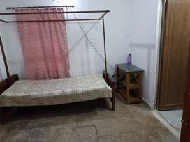 A single room with attached bath suitable for a single male person