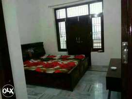 Two bhk flat with marblized floor.Western toilet,big hall