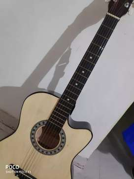 Acoustic guitar only 1 month used excellent condition only at 2100