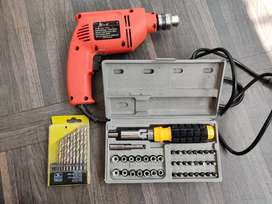 Drilling machine with bit set and multipurpose tools at 700 rs