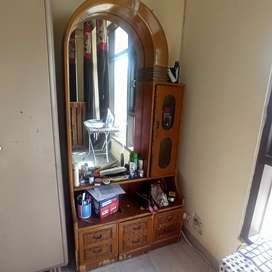 A dressing table with storage available for sale