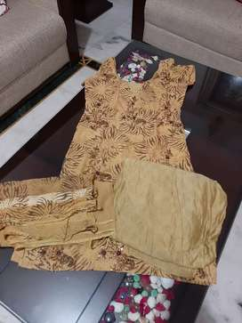 2 designer suits at 700rs each