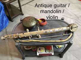 Antique antique indian guitar and voilin cum mandolin