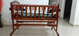 Cot cradles with swing