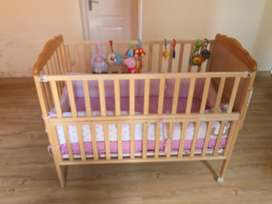 Babyhug Lily Wooden Cot With Detachable Bassinet & Side Shelf