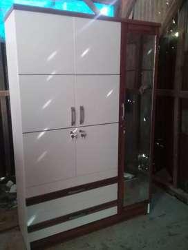Lemari minimalis tiga pintu siap order