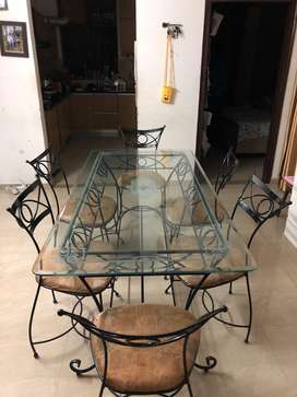 Glass surface including metal chairs