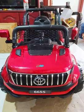Mobil Aki Toyota Merah Unimog