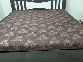 Double bed with bedsheet