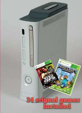"""xbox 360 """"white in color and 500gb storage 34 orignal games installed"""""""