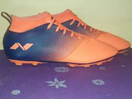 Nivia asthang orange and blue coloured football shoes for sale