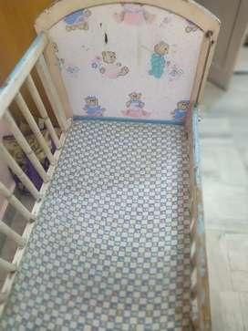 Baby multifunctional woodden cot .