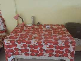 Dining table with chairs and single bed