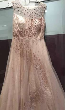 Pink peach full length gown with stone work.