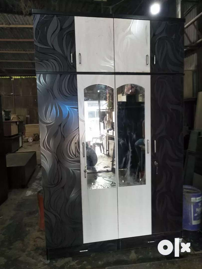 It's New Manufacturing 4 Door And Top Storage Wardrobe 0