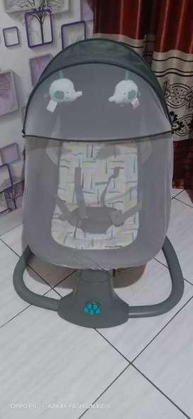 Snuggli ayunan bayi elektrik