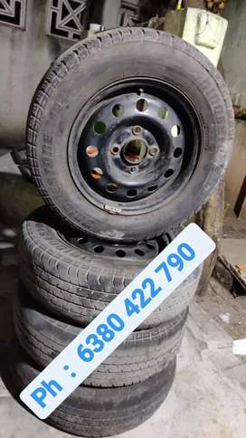 Four  13 inch  Rim with Tyres on Good conditions