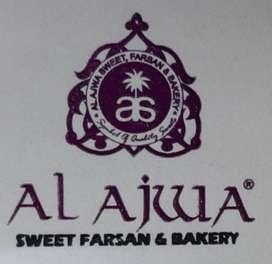 Sotre keeper at Al Ajwa Sweet Farsan and Bakery