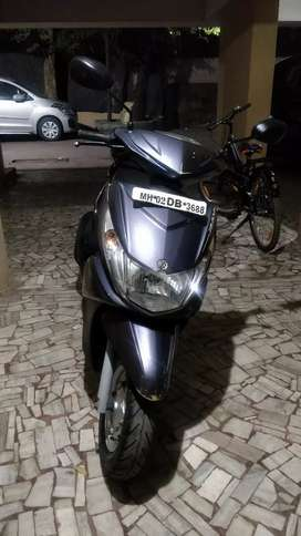 First Owner, Yamaha Ray, 26600kms run, grey color.