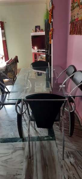 Glass dining table with 6 chairs.