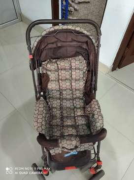 Pram cum stroller with reversible handle and back pocket