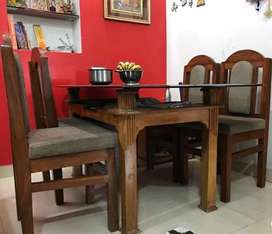 Six seater new black glass table with 4 chair