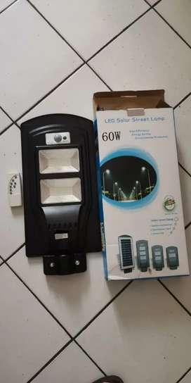 Lampu pju led solar cell 60w remot