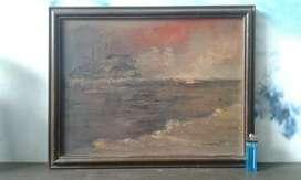 lukisan kanvas dipinggir pantai lawas.