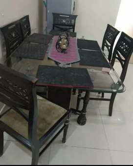 Glass top wooden dining table for sale