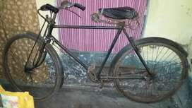 bicycle with one seat, bell, paddle, ring, wheel.