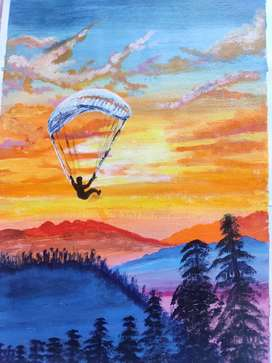 Paragliding boy painting with amazing scenery.