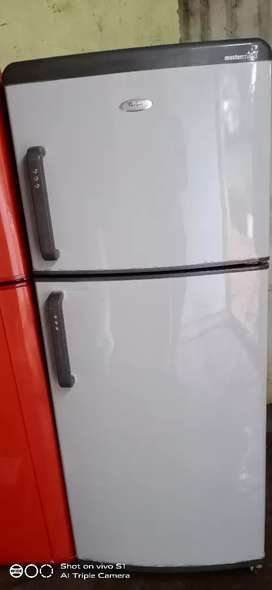 Whirlpool 240 2door refrigerator is good condition