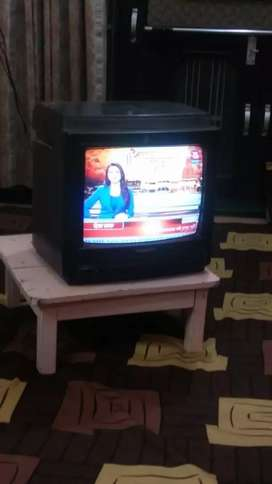 Coloured TV with speaker in working condition