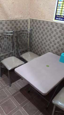 Stlle chirs and table we have 4 seat
