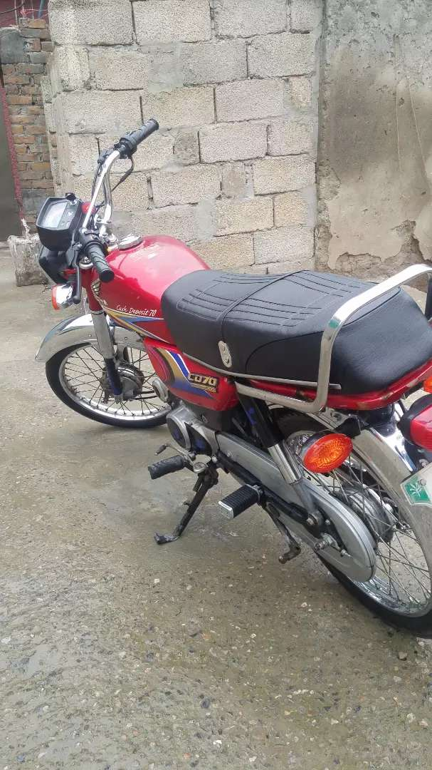 Honda 70 . Red colour . Model 2010. In good condition. 0
