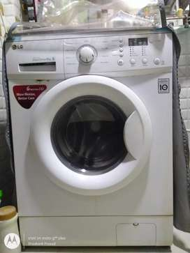 LG washing machine, 6kg, front load, fully automatic.
