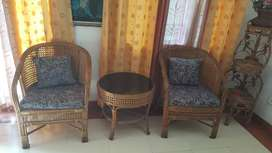 Cane 4 seater sofa set with round table and corner stand.