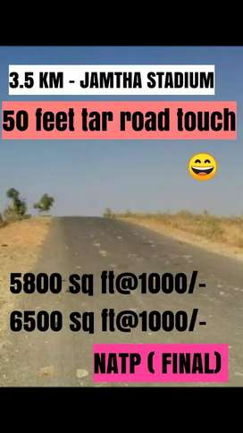 Tar road touch, commercial plot