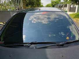 Kaca film mobil anda
