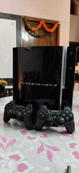 PLAYSTATION 3 with 2 controller and 12 games
