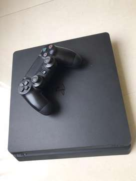 Ps 4 1 tb slim available with warranty and 2 games