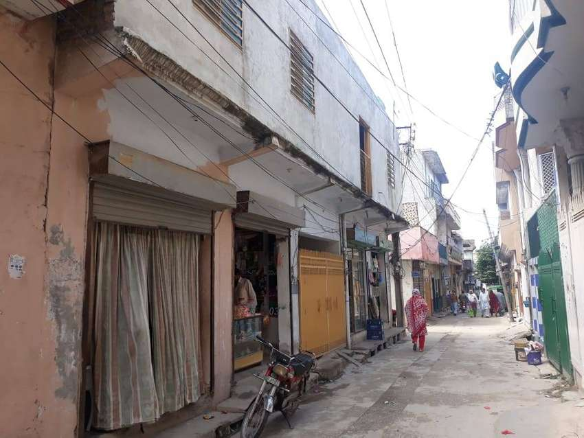 Corner House with 4 shops in market for sale in tramri islamabad 0