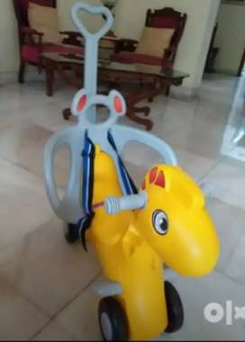 Toy Horse with seat belt, wheels and pulling lever