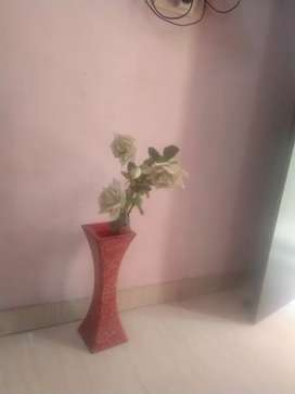 Red colour flower pot height approx 1-1.5 feet with white flowers