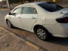 Toyota Corolla GLI 2009 model white color excellent condition