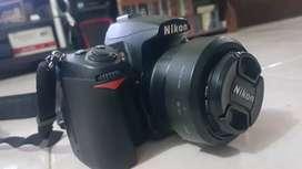 Nikon D7000 + Lensa AF-S Nikkor 35mm 1.8G