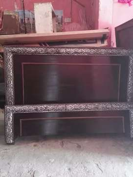 Wooden double bed without mattress