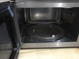 Lg microwave  top model urgent sale